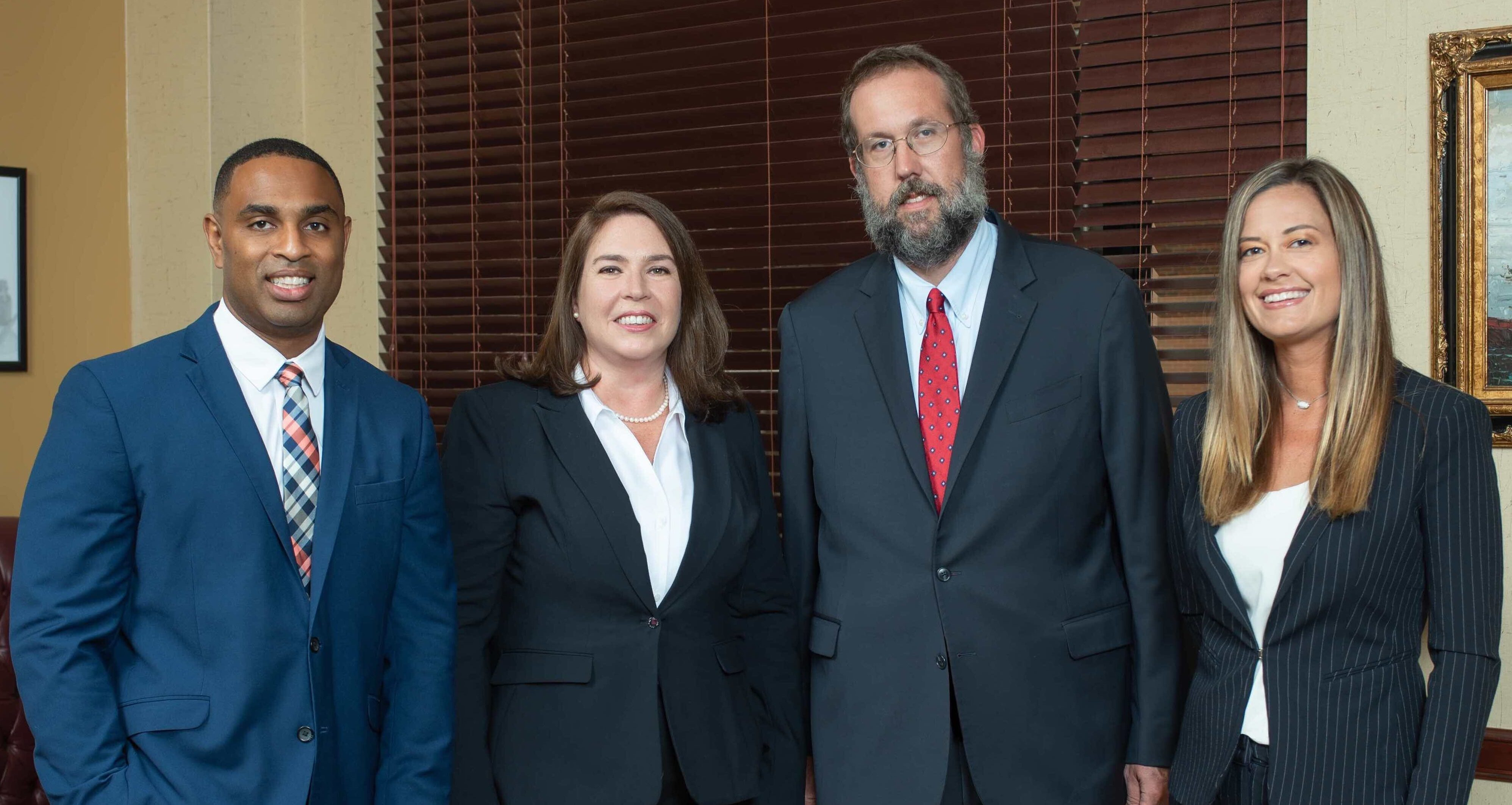four attorneys at sammis law firm